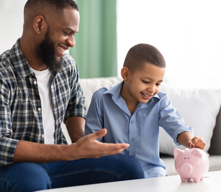 man and son with piggybank