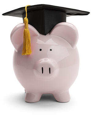 Student Loans - piggy bank with cap